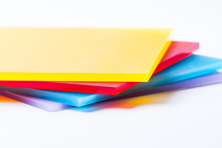 Orange yellow red blue purple plexi glass sheets on the white background