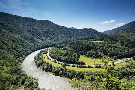View of highway, river, forest and grassland, Domašínský meandr in Slovakia Reklamní fotografie