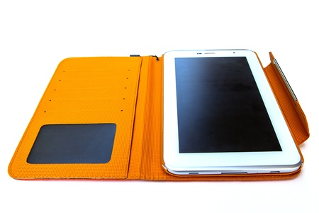 Tablet computer in orange case Stock Photo - 17434572