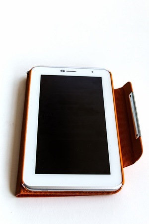 Tablet computer in orange case Stock Photo - 17434605