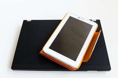 Tablet in orange case put on laptop Stock Photo - 17434562