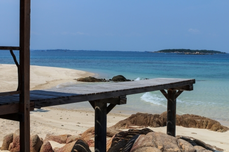 Beautiful wooden pier on beach at Monnok island, Rayong, Thailand photo