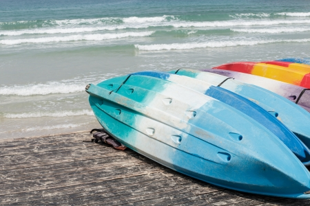 Colorful fiberglass kayaks on the beach at koh kood island, Thailand