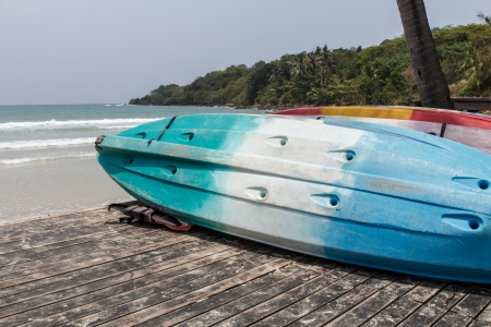 Colorful fiberglass kayaks on the beach at koh kood island, Thailand photo