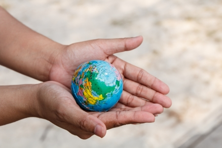 Concept of woman hand protect the Earth Stock Photo - 19139867