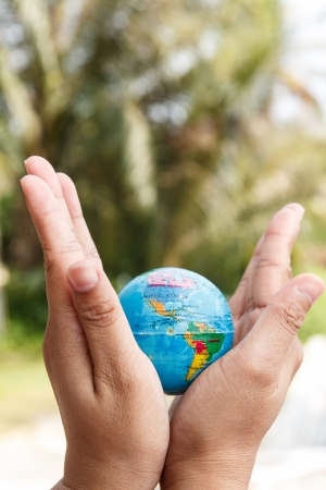 Concept of woman hand protect the Earth Stock Photo - 19139873
