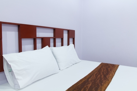 Comfortable soft pillows on the bed Stock Photo - 19292987