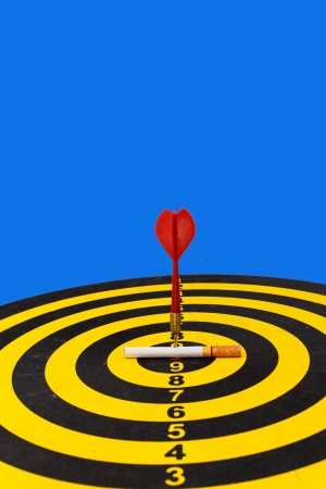 Red darts target to stop smoking concept on blue Stock Photo - 19434176
