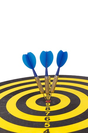 Three blue arrow darts on the target in red photo