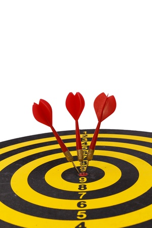 Three red arrow darts on the target in red photo