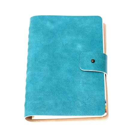 Leather cover of green notebook on white background photo