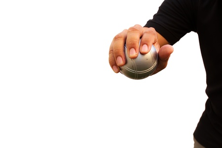 Man and petanque ball in hand photo