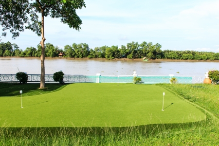 Mini golf field at the river side photo