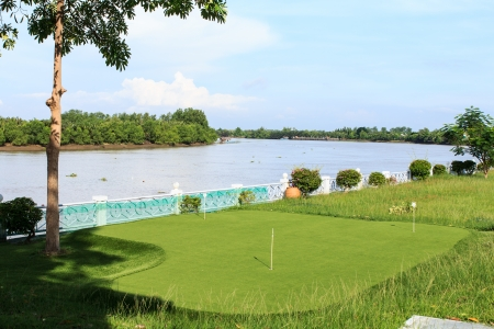 Landscape of mini golf field at the river side photo
