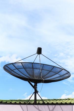 satellite dish against the blue sky photo