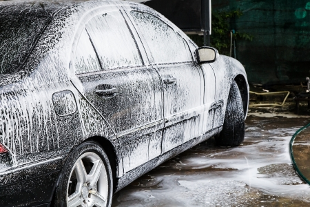 The black car in a carwash Standard-Bild