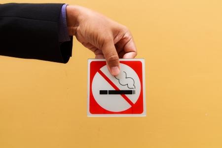 Business man hand show no smoking symbol photo