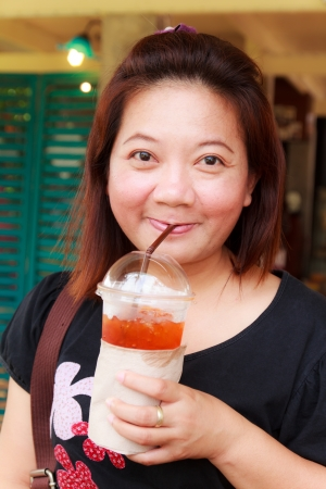 Close up of happy woman drink tea Stock Photo - 21126122