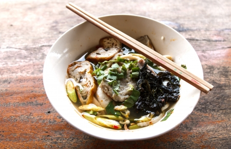 thai noodle soup: Thai Noodle Soup with fish and herbal Stock Photo