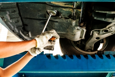 Man hand changing motor oil to engine photo