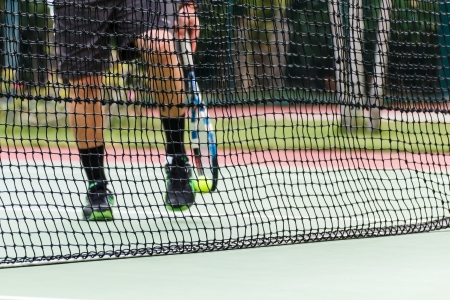 tramline: Tennis court on the game at day time Stock Photo