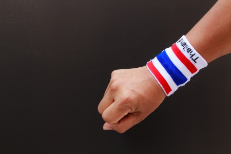Man hand with wristband which Thailand flag colors