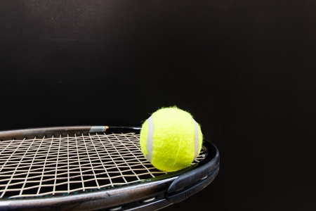 Tennis Ball and Racket isolated with black Standard-Bild