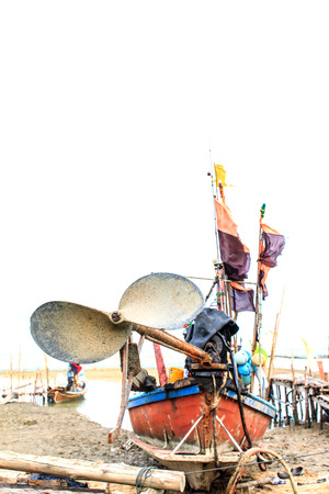cilinder: Propeller in fishing boat on the beach, Nakhon Si Thammarat Thailand Stock Photo