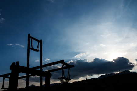 Silhouette wooden swing with sky  photo