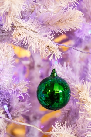 Green ball on Christmas tree