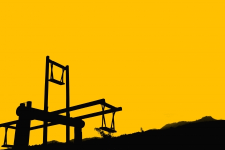 Silhouette wooden swing with sky background photo