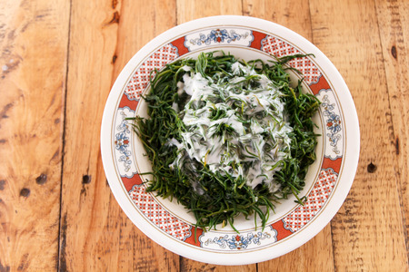 Vegetable fired with coconut milk on wooden table photo