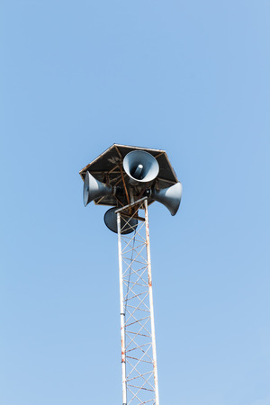 Four loudspeaker against blue sky