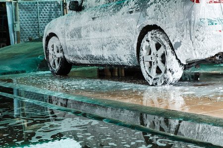 Cars washing with foam in a carwash Standard-Bild