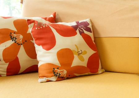 Beautiful handmade pillows on sofa