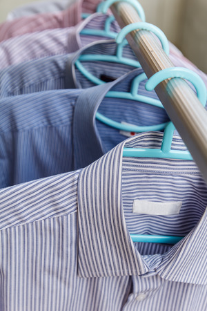 drycleaning: Man shirt wait for dry during daytime