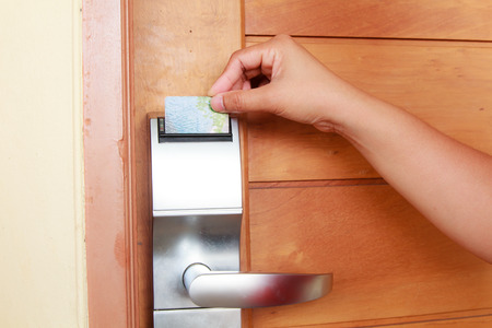 cardkey: Hand open electronic key system to lock and unlock doors Stock Photo