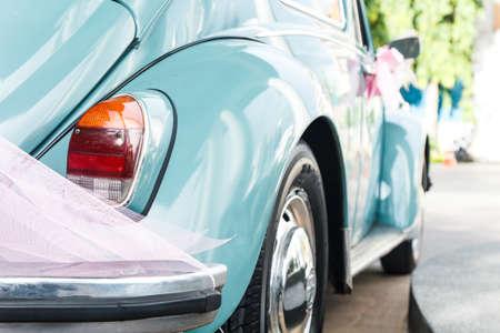 Classic vintage wedding car in green