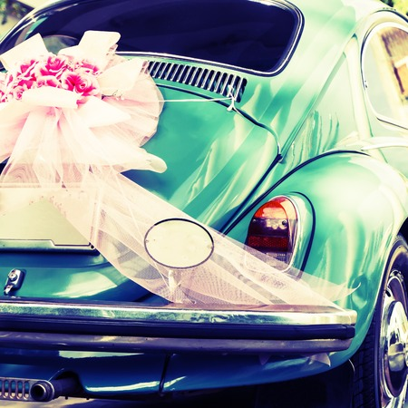 Vintage green wedding car parking