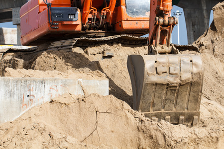 Part of Orange Construction Excavator at Work site photo