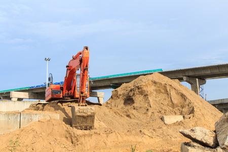 Orange Construction Excavator at work site photo