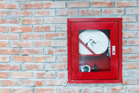 Close up old fire extinguisher cabinet photo