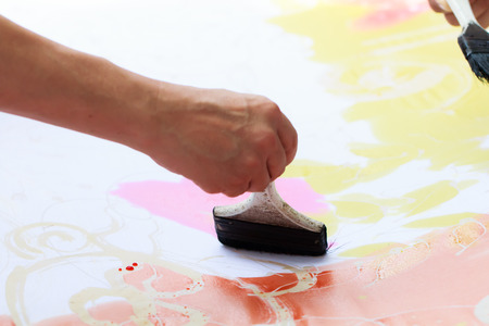 creationism: Part of body is painting picture with paintbrush Stock Photo