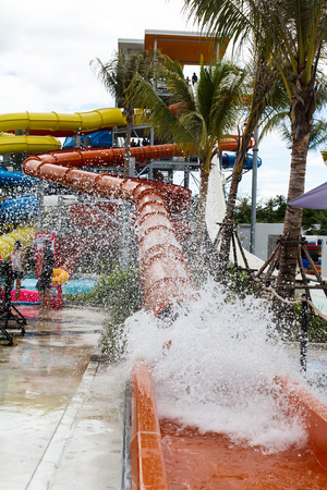 People in action with sliders in water park