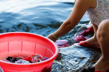 Part of woman washing cloth at the river Banco de Imagens