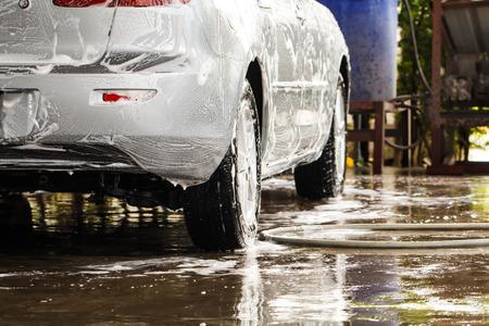 dirty car: Car when washing in the carwash Stock Photo