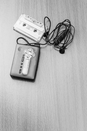 earpiece: Top view of Audio cassette with audio tape and earpiece Stock Photo