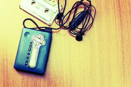 earpiece: Audio cassette with audio tape and earpiece-2 Stock Photo