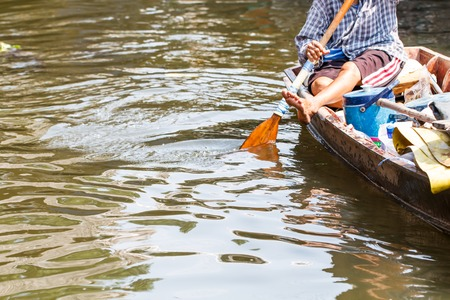 Close-up people with small boat at the float market-2 photo