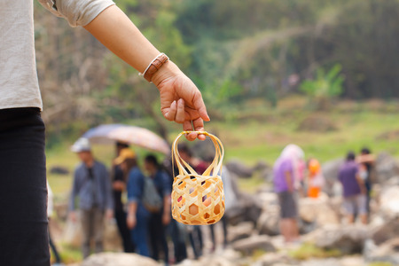 volatile: Hand carry boiled eggs with tourist background in hot spring at Jaeson National Park in Lampang, Thailand